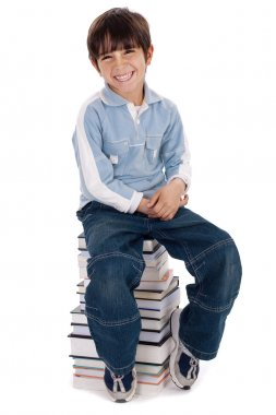 Young kid sitting over pile of books