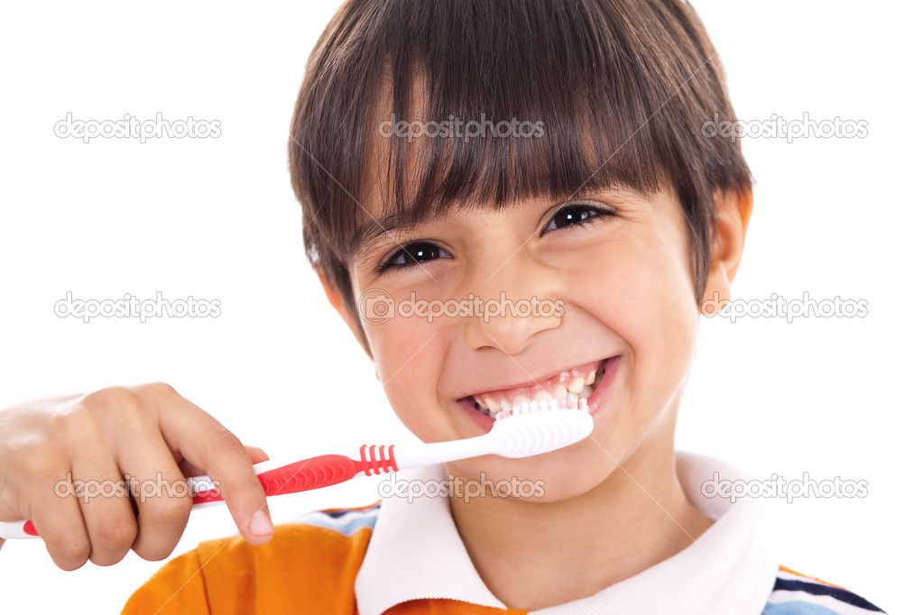 Closeup of cute kid brushing his teeth on isolated white background