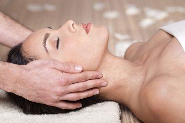 Happy woman receiving head massage