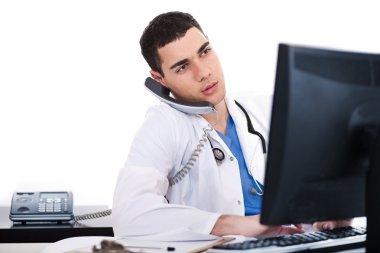 Doctor logging his notes in computer