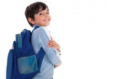 Happy young boy ready for school