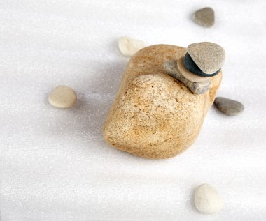 Pile of stones and the scattered pebble