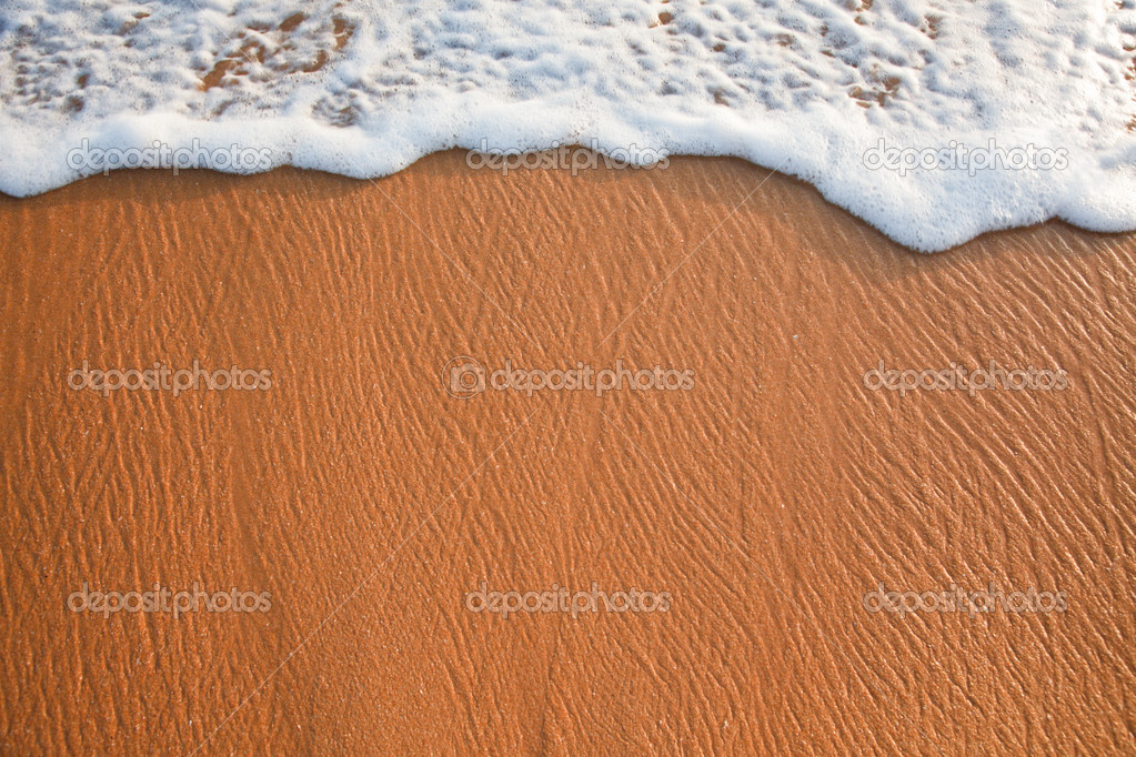 Wave surging on sand