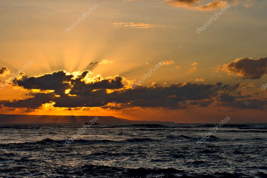 Calm ocean and beach on tropical sunrise