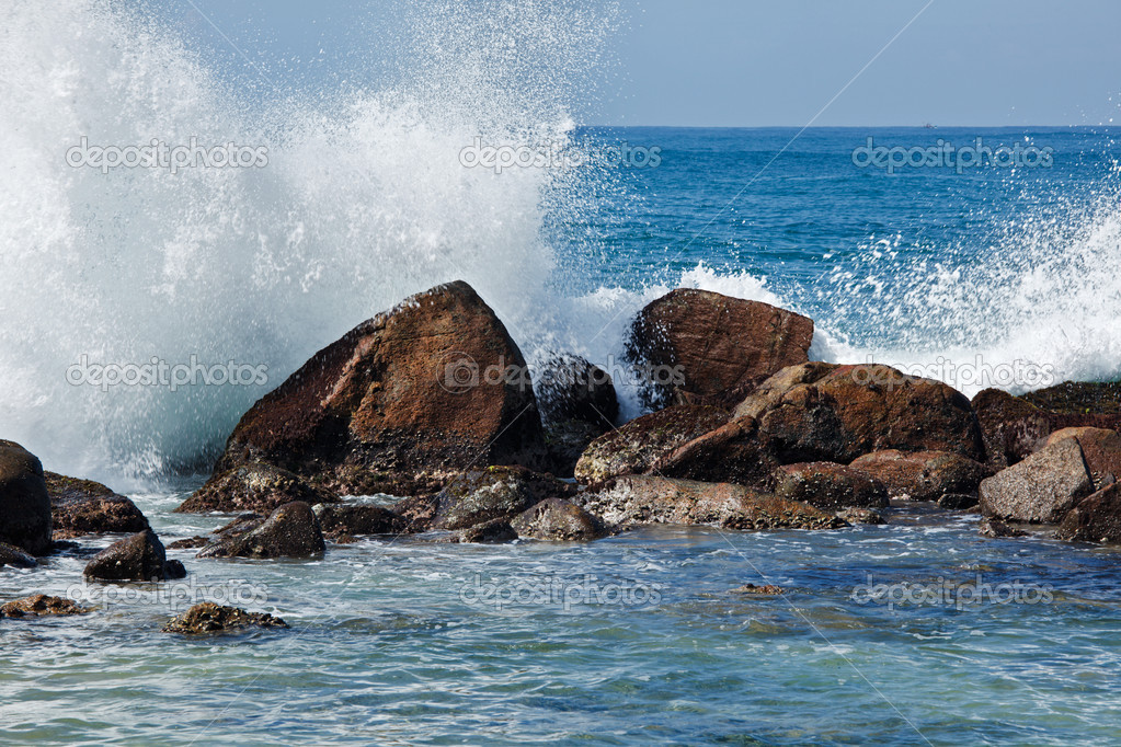 Waves breaking against the rocks