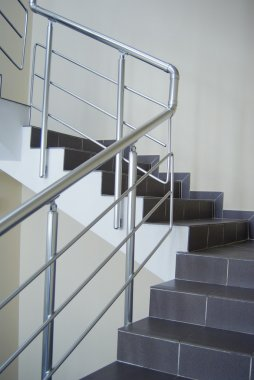Enclosure with metallic stair railing