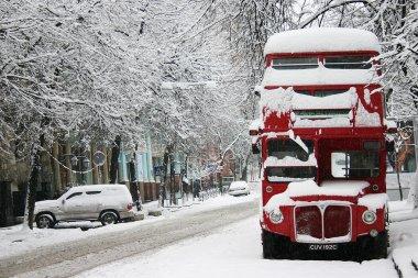 Red double-decker in winter