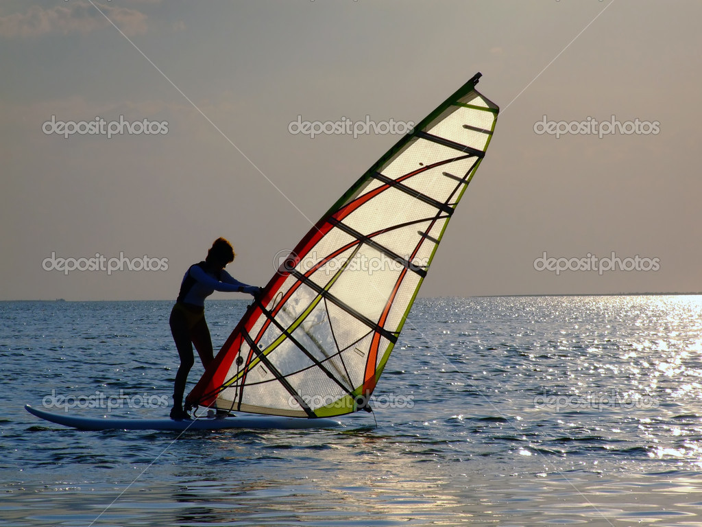 A women is learning windsurfing at the s