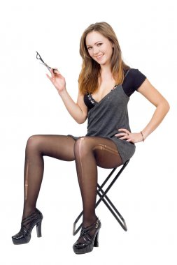 Girl with scissors in the torn stockings