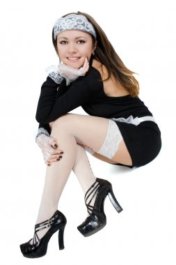 Sexy smiling young maid. Isolated on whi
