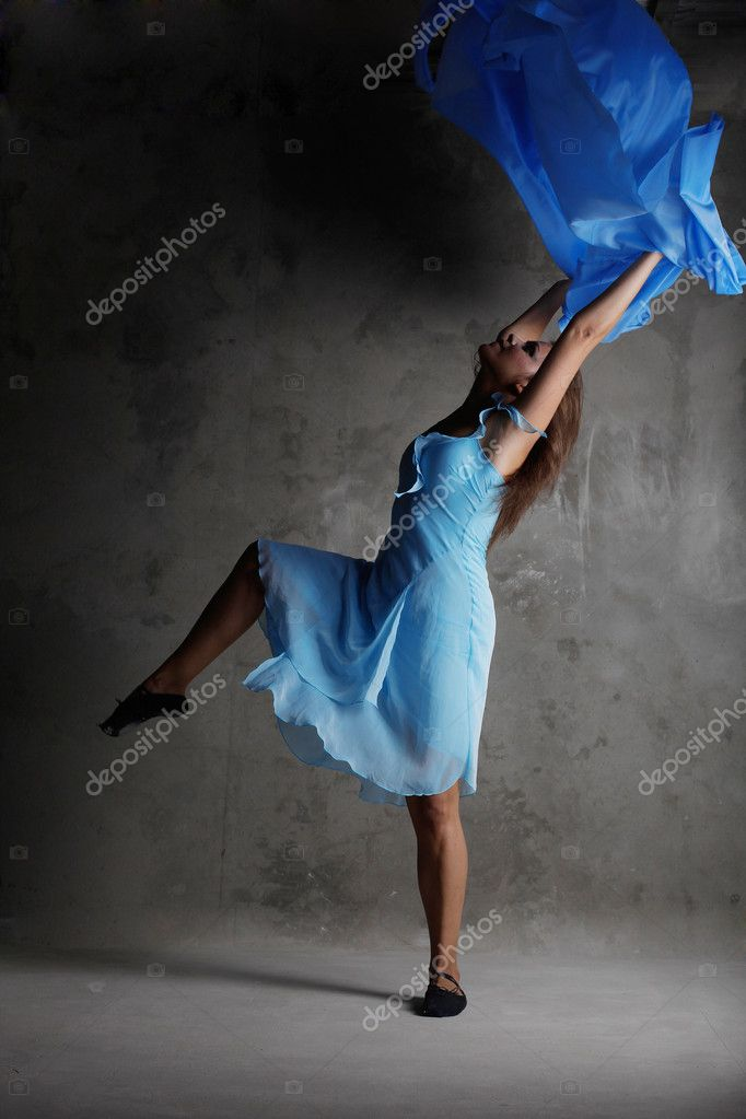 Young modern dancing girl in colorful dress