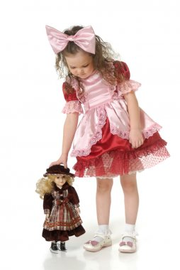 The little girl with doll
