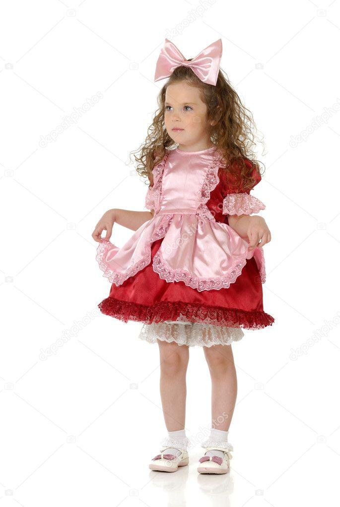 la niña en un atuendo festivo — Foto de stock © Albert_Smirnov #1640067
