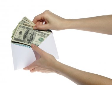 Hands and money in envelope isolated