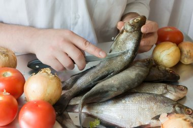 Hands of cooking men