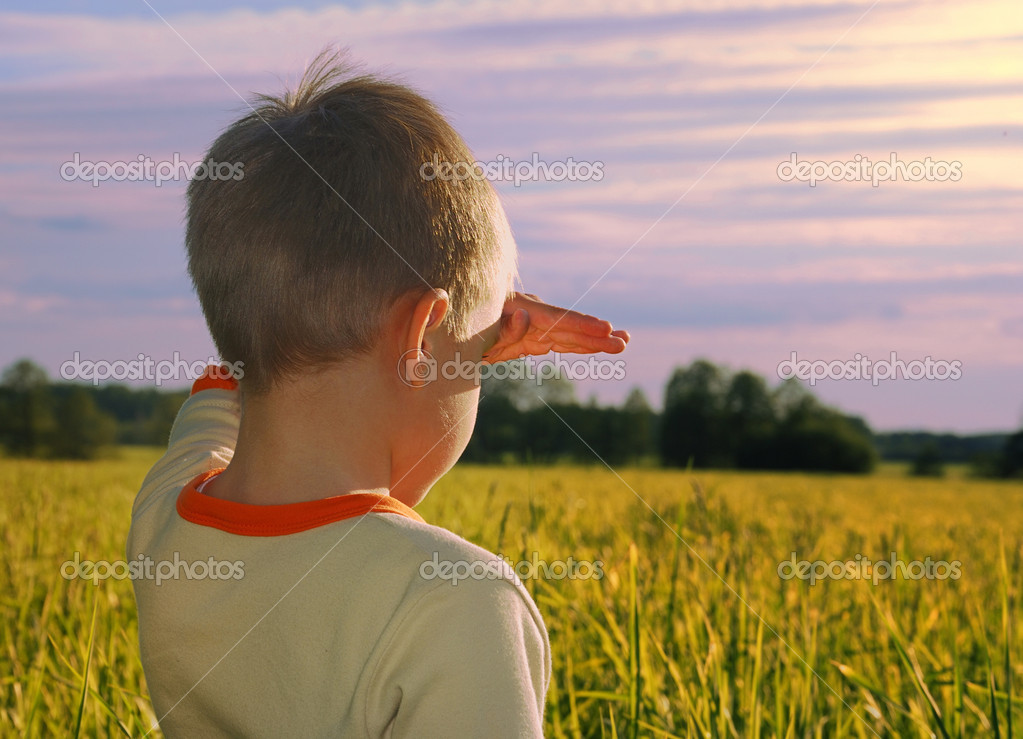 Happy young boy looking horizon in sundo