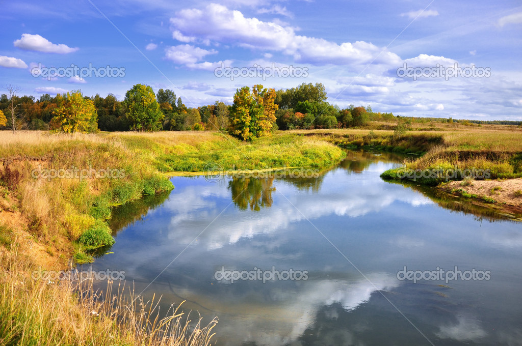 Autumn landscape of river and trees and