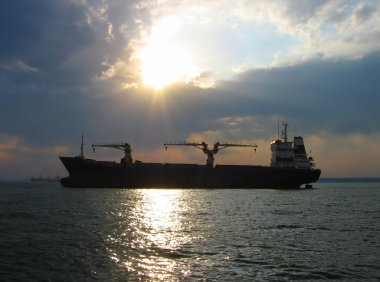Dry cargo ship at sunset 2