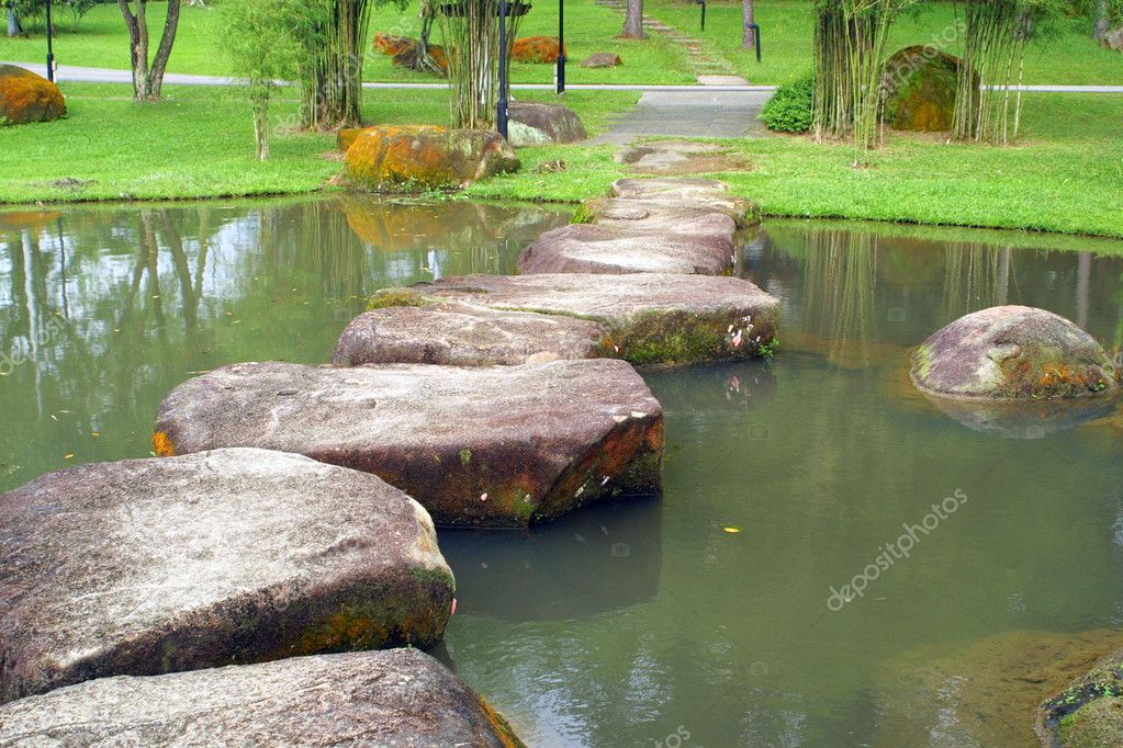 Stoneway and small lake in the garden