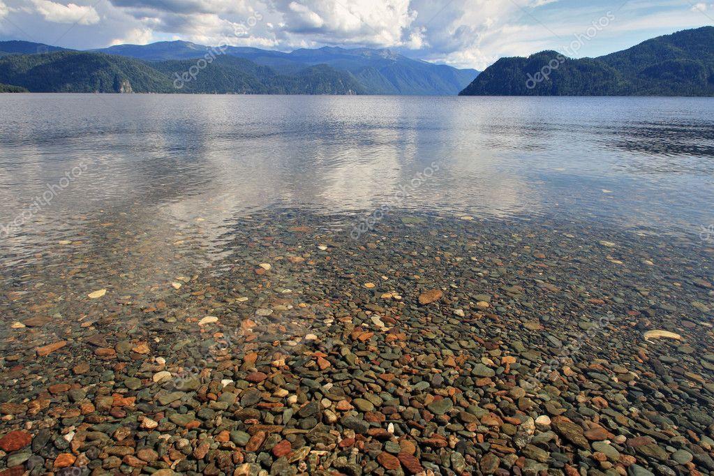 Transparent water of lake Teletskoe