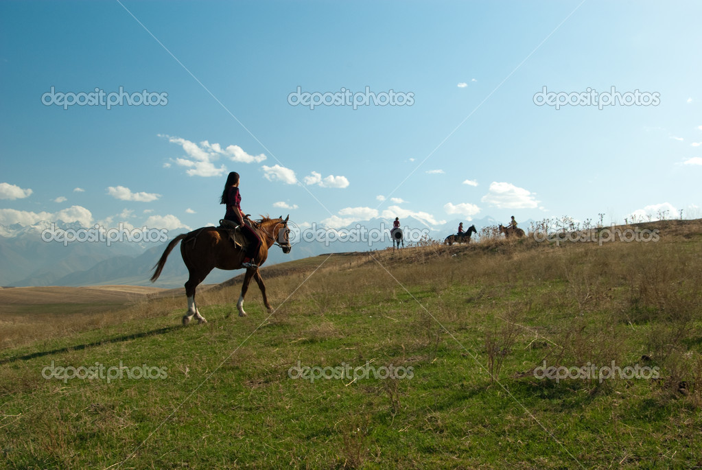 Gril riding a horse