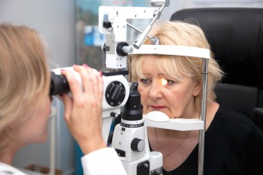 Doctor, and patient in ophthalmology lab