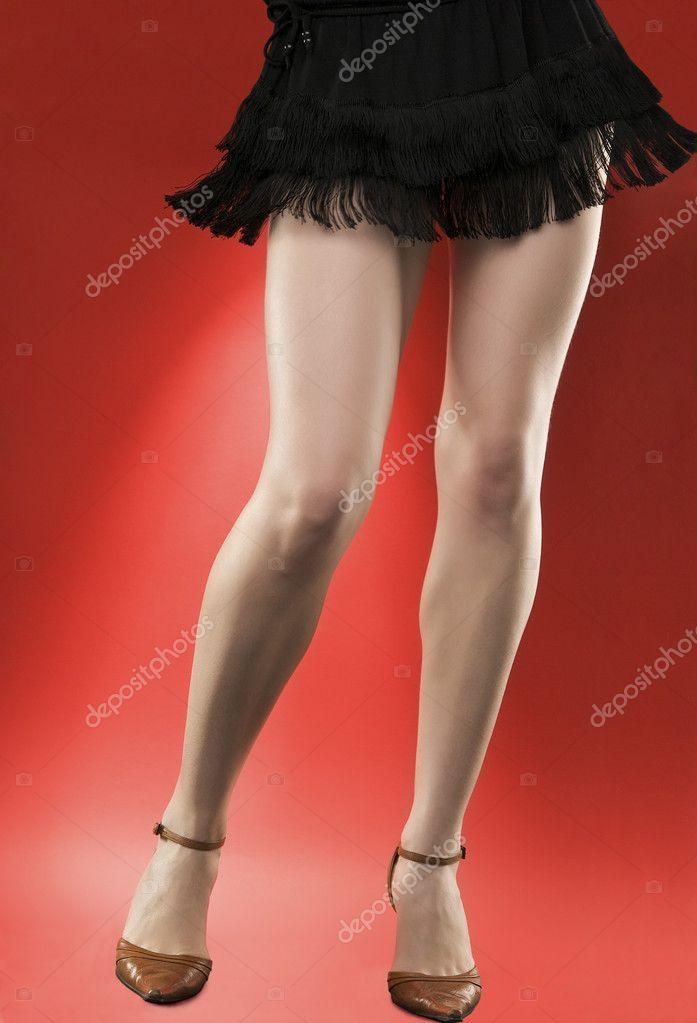 Woman's long legs on high heels