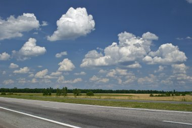 Empty road and cloudy sky