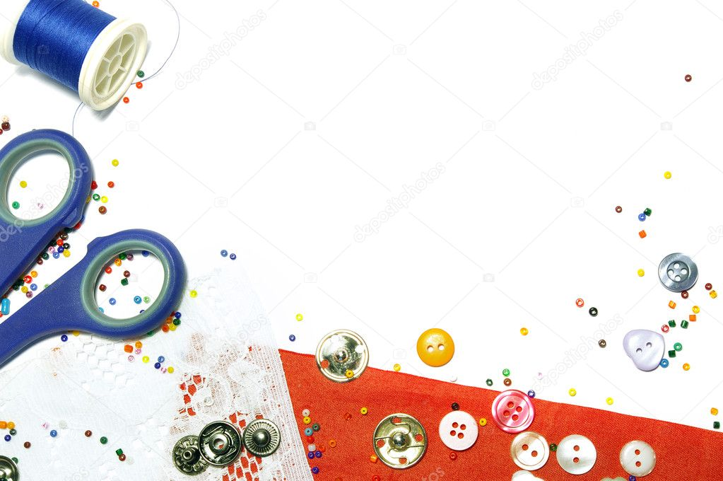 Red fabric, buttons and colorful beads as background