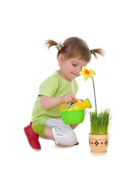 Cute girl watering the flower