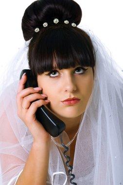 Sad bride speaks on the phone