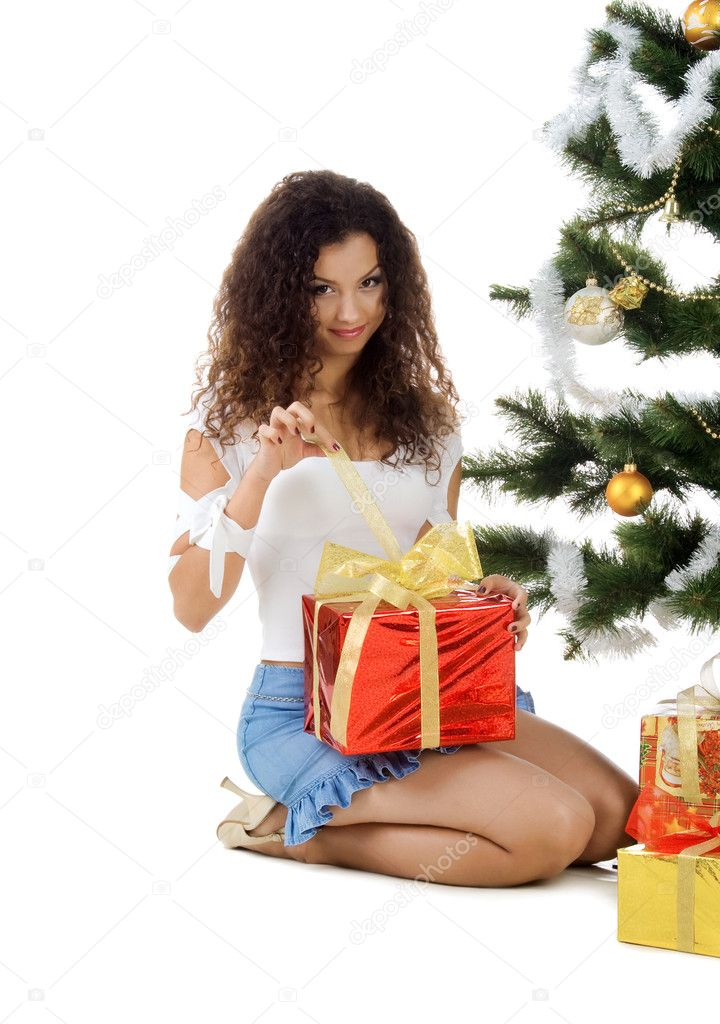 Cute young woman decorate christmas tree