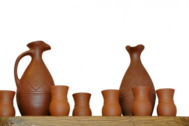 Clay jugs cups isolated on white