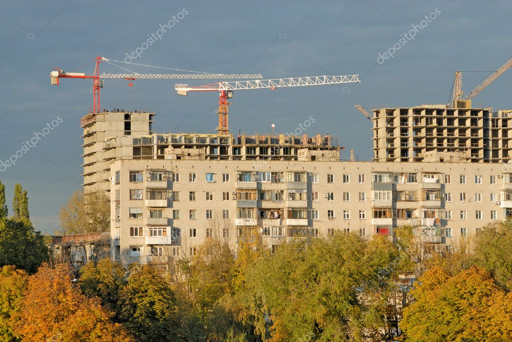 Old apartment house against construction