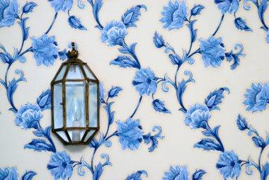 Lamp on vintage wallpaper