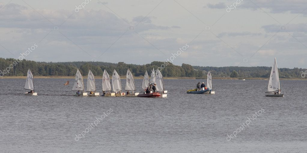 Sailboats on the forest lake