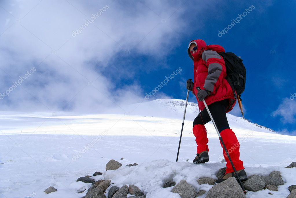 Girl - an alpinist in red jacket