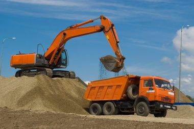 Excavator and dump truck