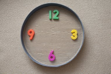 Toy clock made from magnetic digits