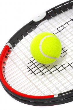 Tennis racket with a ball on a white bac