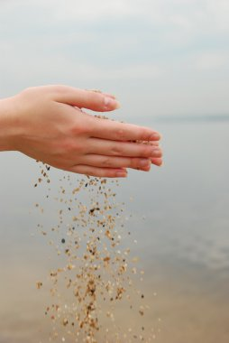 Sand in female hands