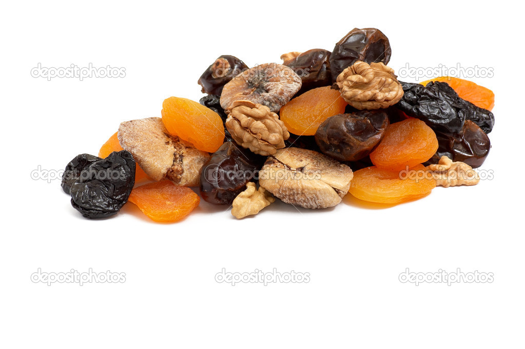 Heap of dried fruits and walnuts.