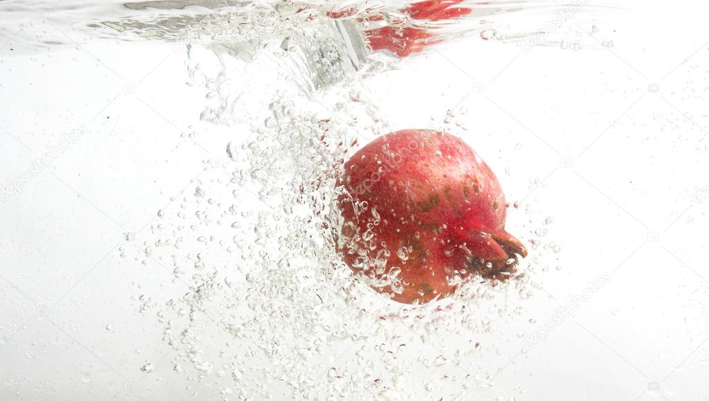 Fresh pomegranate in water.