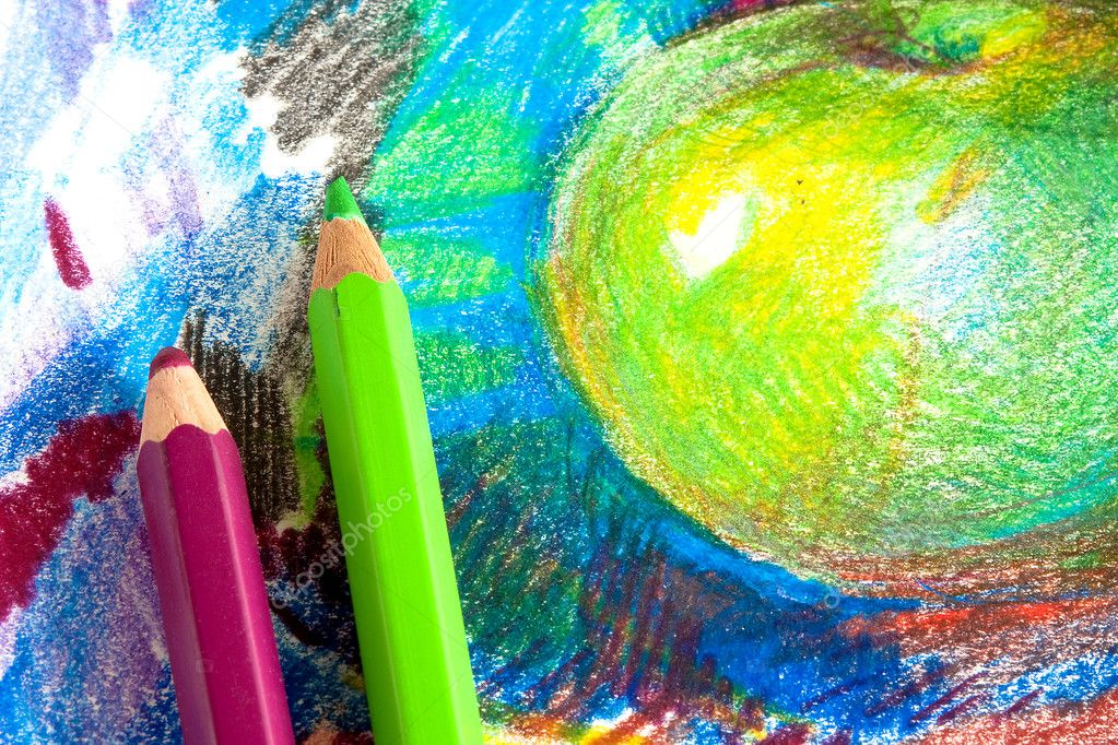 Child drawing by colored pencils