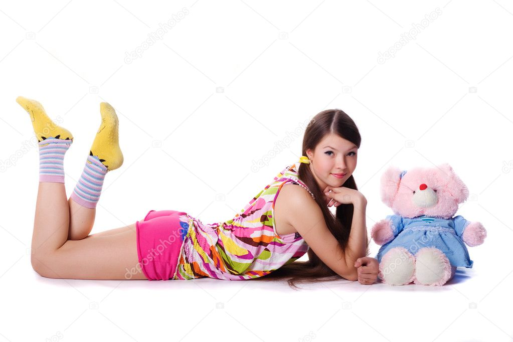 Lovely young girl with a toy