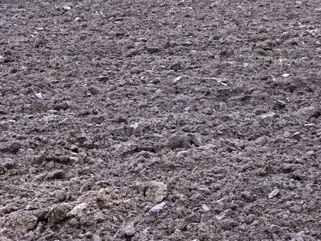 Fallow ploughed field background