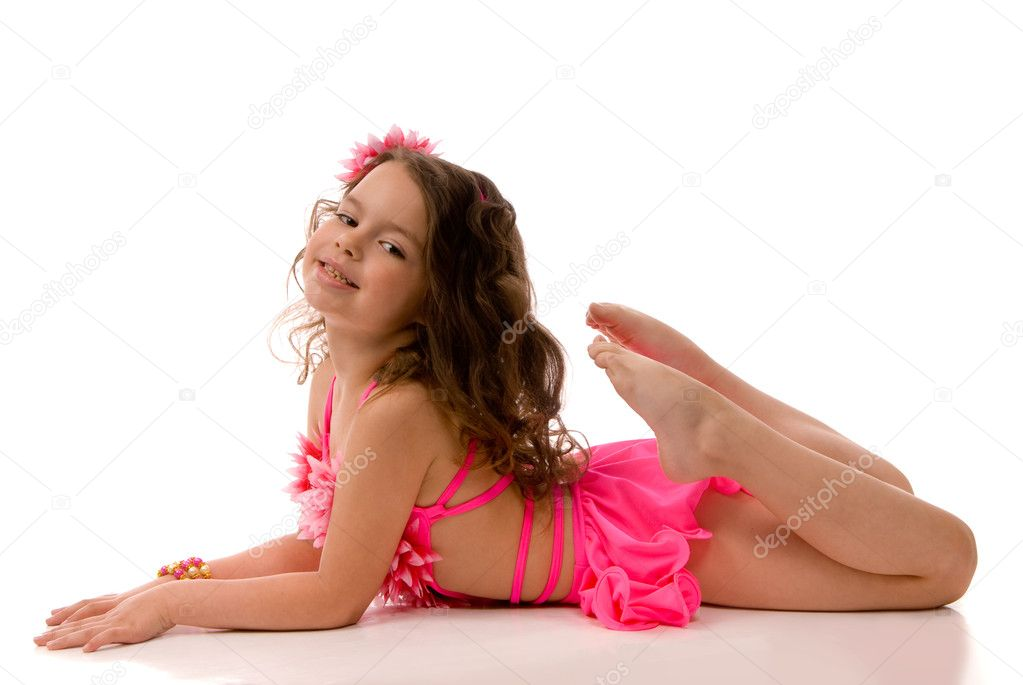 Beautiful little girl in pink swim suit