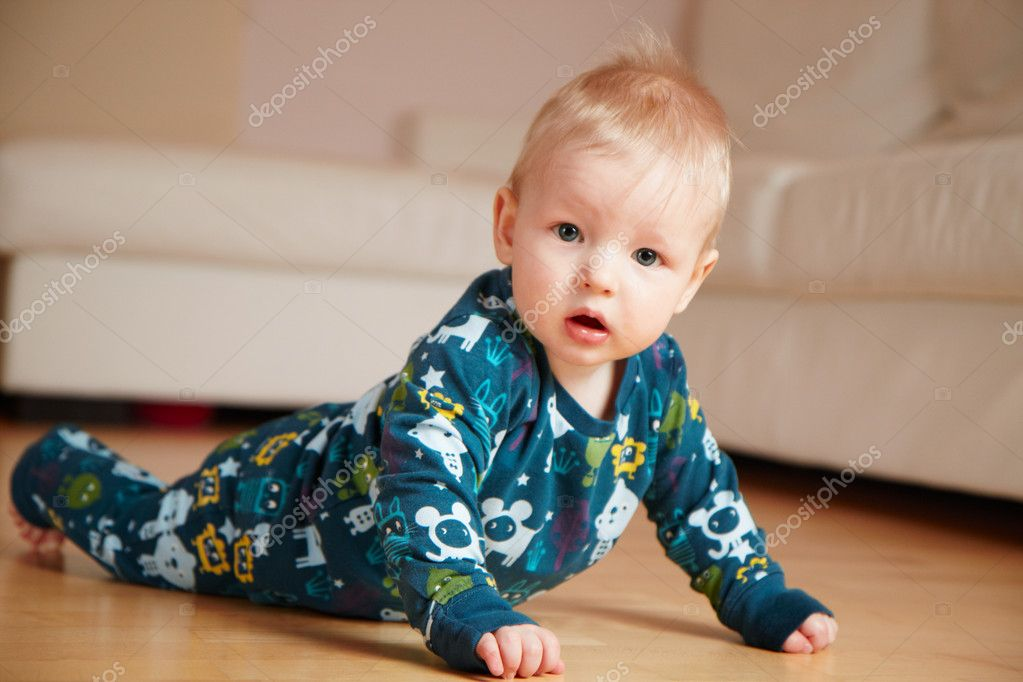 6 month old baby crawling on floor at home stock photo noblige 1136266. Black Bedroom Furniture Sets. Home Design Ideas
