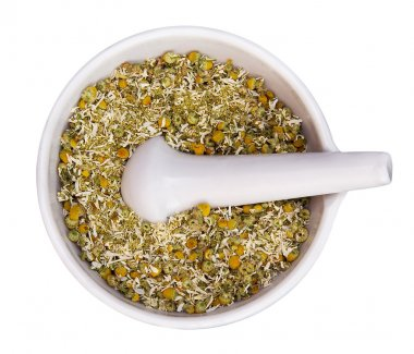 Mortar and pestle with dry herbs