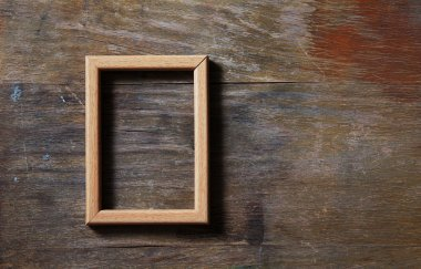 Empty frame on wooden background